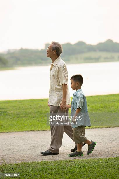 Grandfather and grandson walking hand in hand