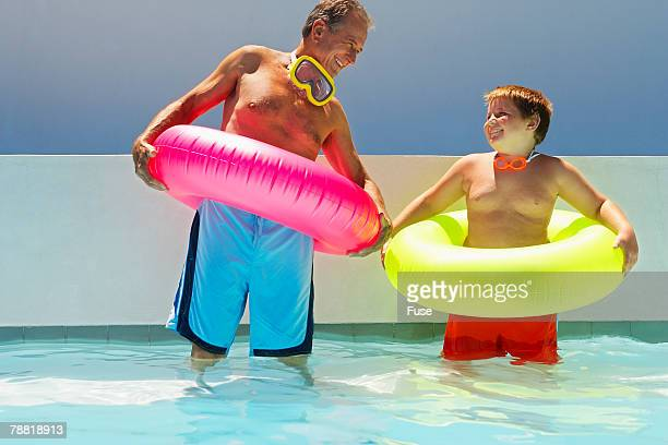 Grandfather and Grandson Wearing Inner Tubes