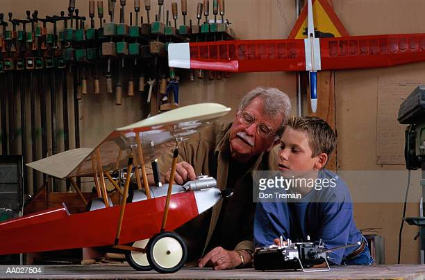 Grandfather and Grandson with Model Airplane