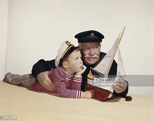 Grandfather and grandson with model ship