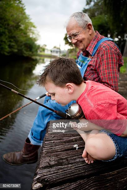 Grandfather and Great Grandson Fishing on Wood Dock