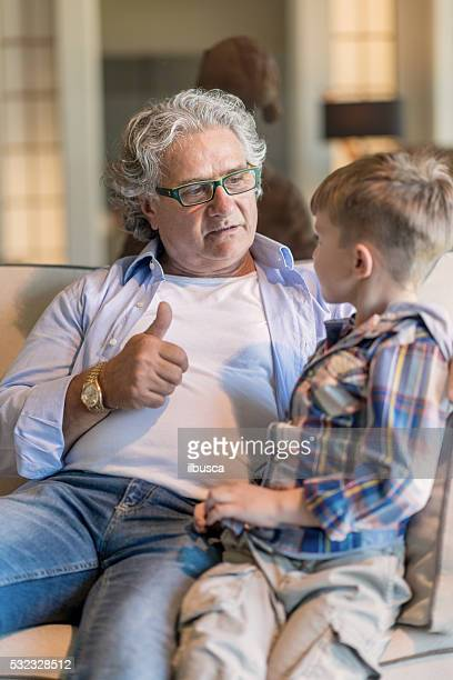 Grandfather and nephew in the living room