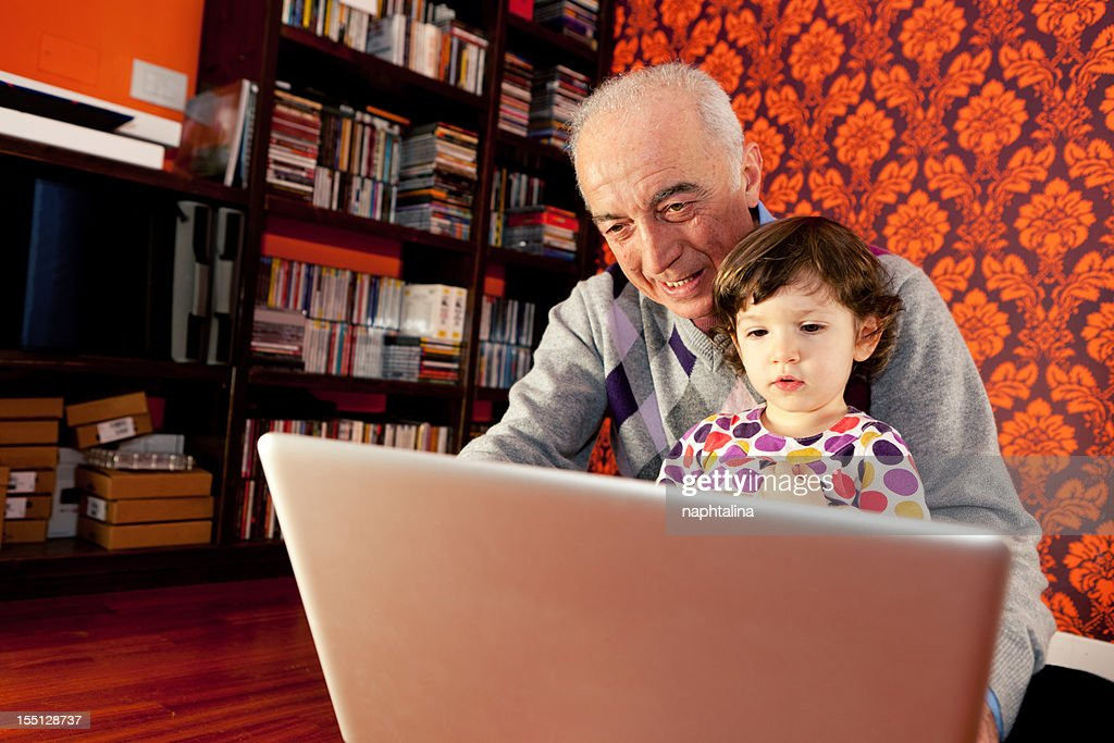 grandfather and niece at computer : Stock Photo
