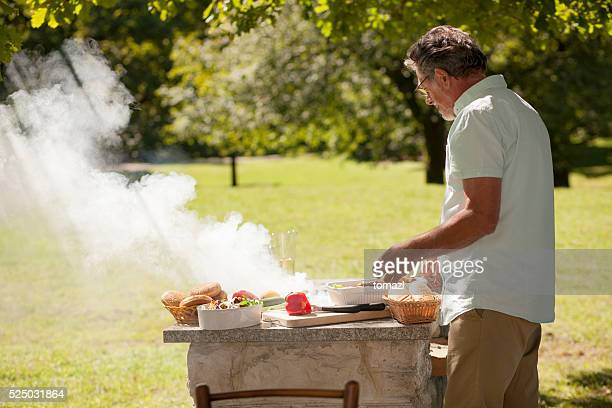 Grandfather at barbecue