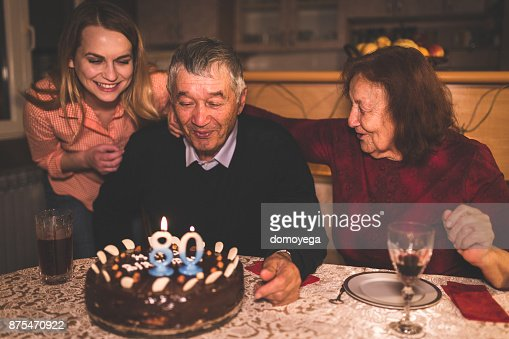 Grandfather celebrating birthday with his family at home