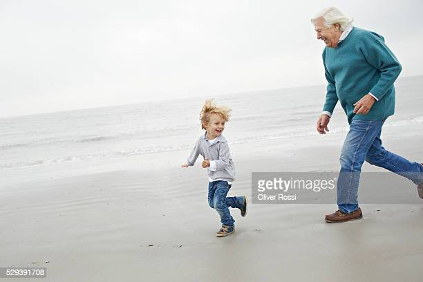 Grandfather chasing grandson