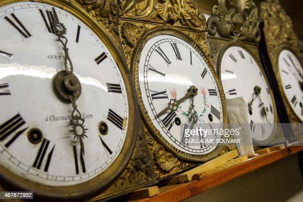 Grandfather clocks are pictured in a clock collection in central France on March 24 2015 This year clocks will spring forward an hour to summer time...