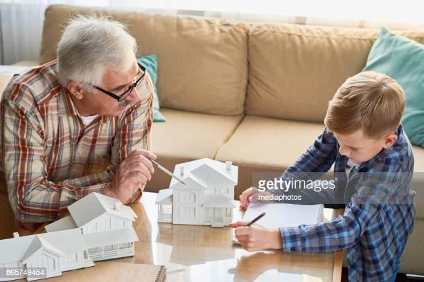 Grandfather developing skill of grandson