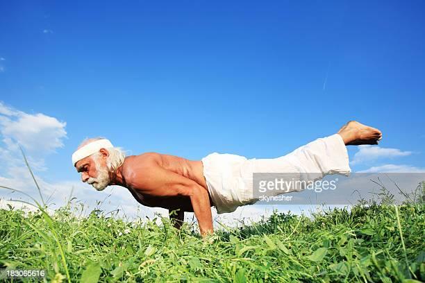 Grandfather doing yoga .