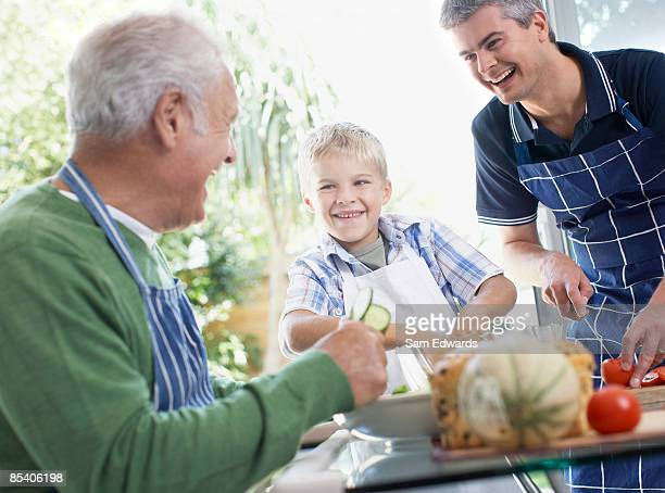 Grandfather, father and son preparing healthy meal