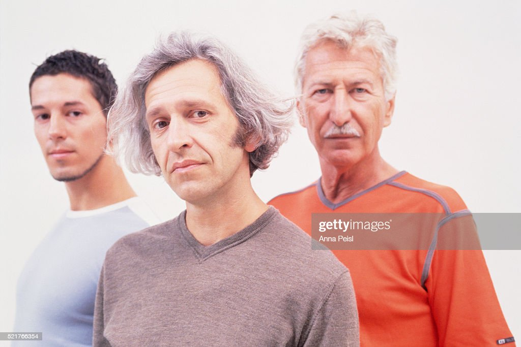 0a8d21553 Grandfather Father And Son Standing Together Stock Photo | Getty Images