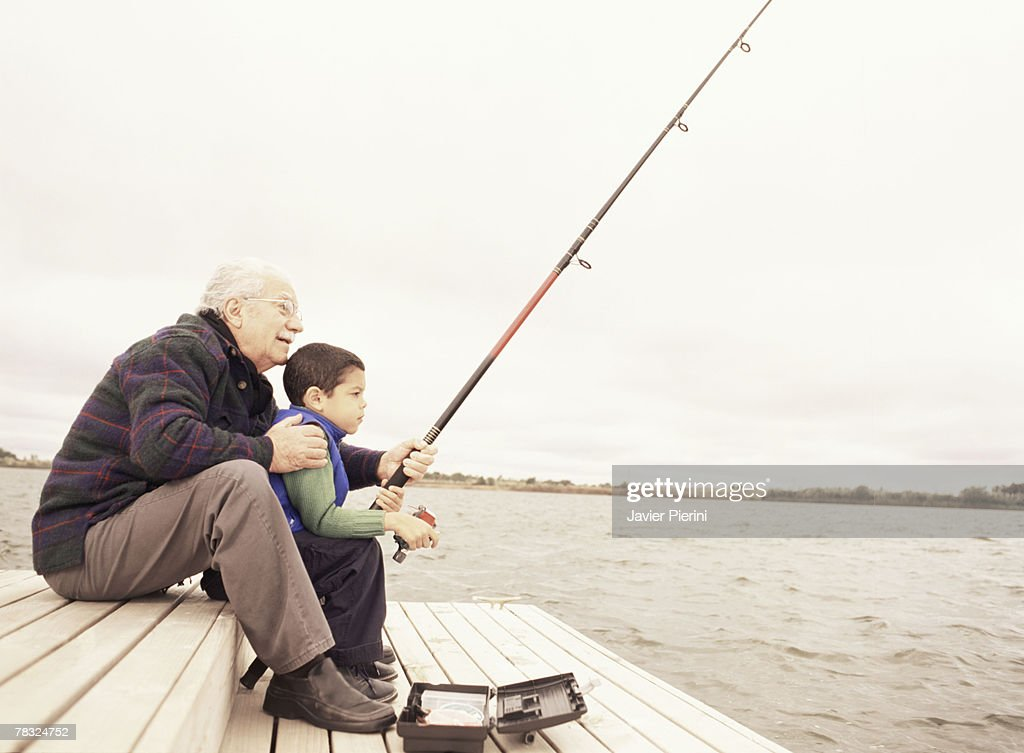 Grandfather fishing with grandson : Stock Photo