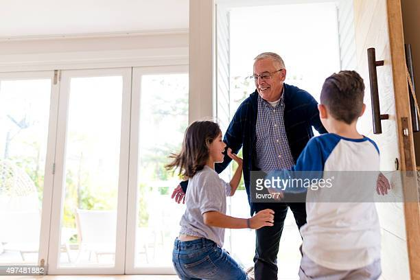 grandfather greeting his children - arrival stock pictures, royalty-free photos & images