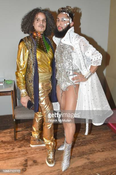 Grandfather Hector Xtravaganza and G Bizarre Xtravaganza attend the 2018 Aperture Gala at Cedar Lake on October 30 2018 in New York City
