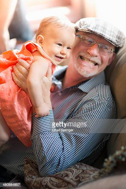 Grandfather holding granddaughter