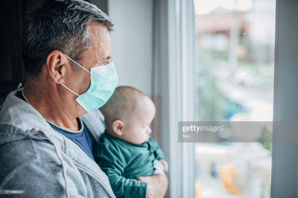 grandfather into quarantine with his grandson : Stock Photo
