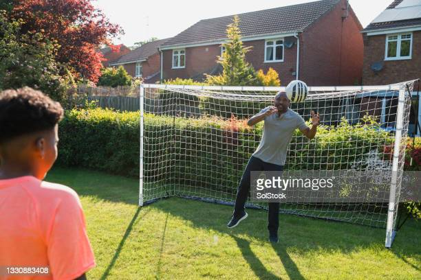 grandfather is in goal - shooting at goal stock pictures, royalty-free photos & images