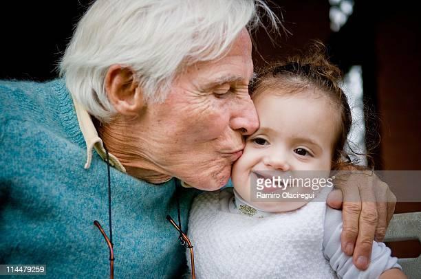 Grandfather kissing granddaughter