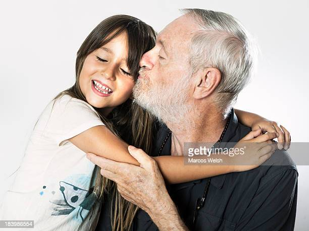 Grandfather kissing granddaughter