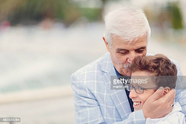 Grandfather kissing his grandson