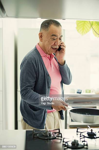 Grandfather making a hot cake at home.