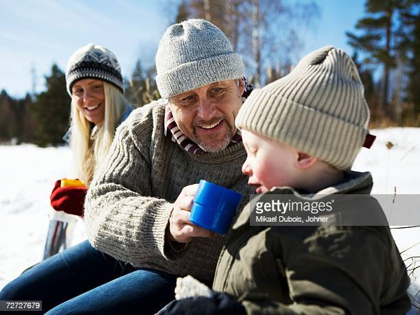 Grandfather on a picnic with grandchildren.