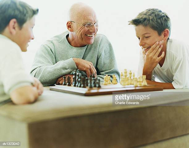 Grandfather Playing Chess With His Grandsons