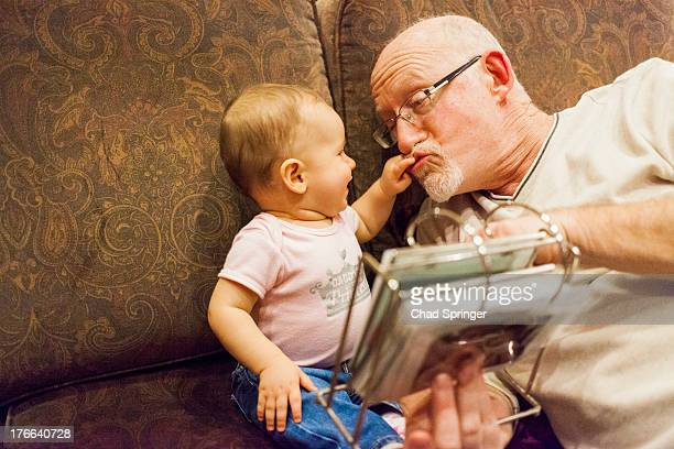 Grandfather playing with baby granddaughter