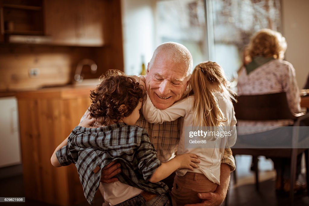 Grandfather playing with his grandkids : Stock-Foto
