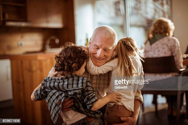 grandfather playing with his grandkids - love emotion stockfoto's en -beelden