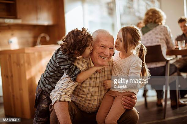 grandfather playing with his grandkids - senior lunch stock photos and pictures