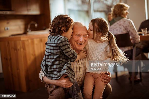 grandfather playing with his grandkids - grandfather stock pictures, royalty-free photos & images