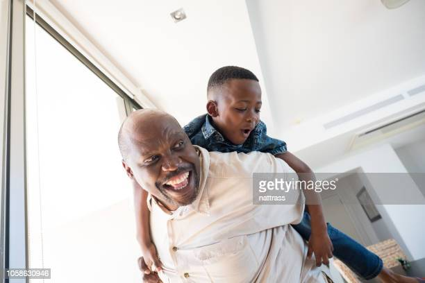 grandfather playing with his grandson - innocence stock pictures, royalty-free photos & images