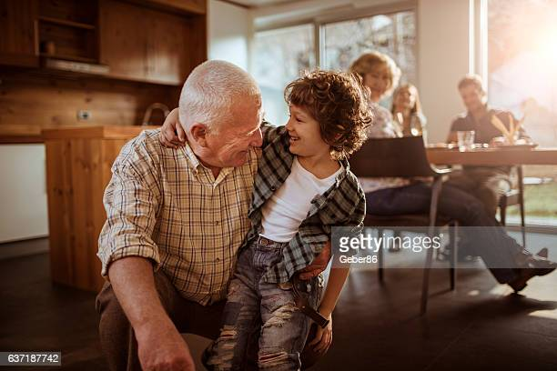 grandfather playing with his grandson - senior lunch stock photos and pictures