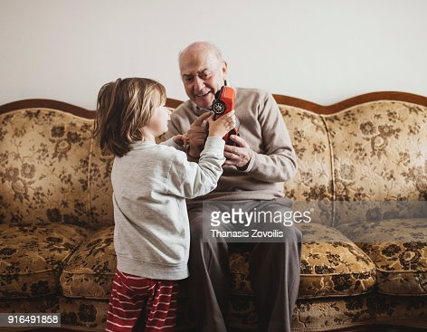 Grandfather playing with his grandson