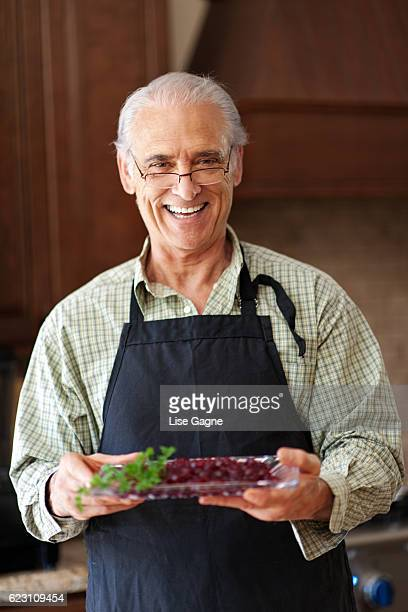Grandfather preparing thanx giving dinner