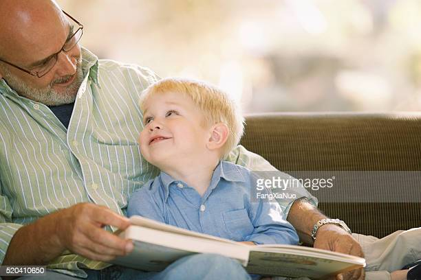 Grandfather reading with his grandson