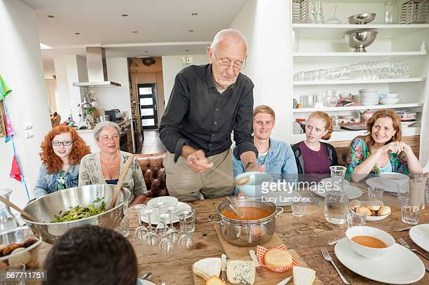 Grandfather serving soup