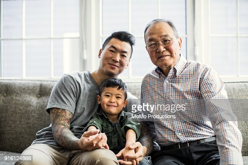 Grandfather, Son and grandson on couch at home
