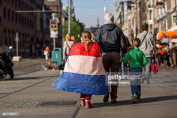 Grandfather taking kids to Kingsday 2014