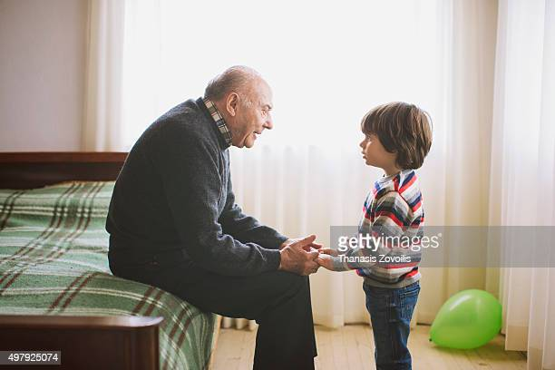 Grandfather talking to his grandson