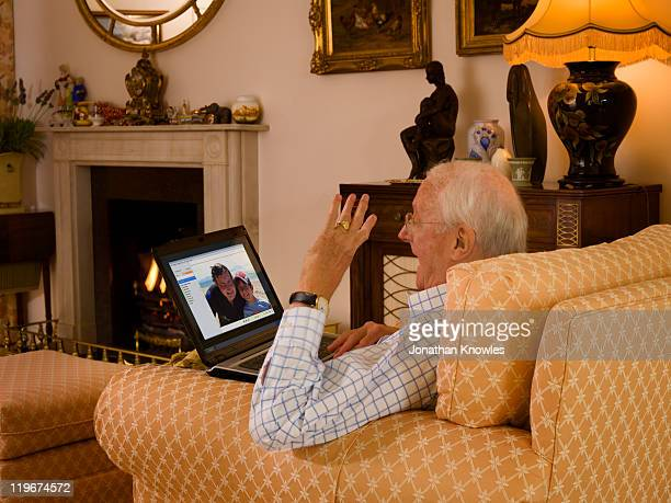 a grandfather talking to son and grandson while th - waving stock pictures, royalty-free photos & images