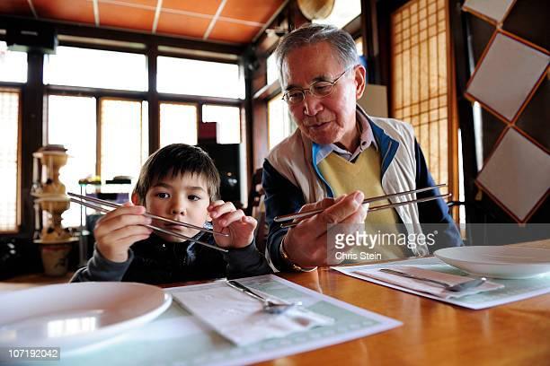 Grandfather teaching his grandson
