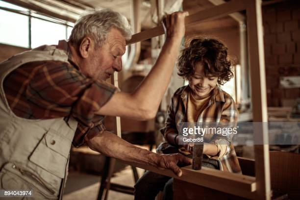 Grandfather teaching his grandson