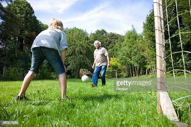 Grandfather tries to score a goal