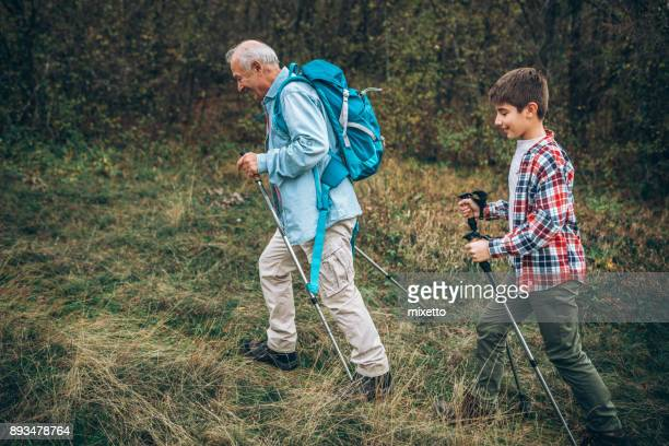Grandfather walking with his grandson