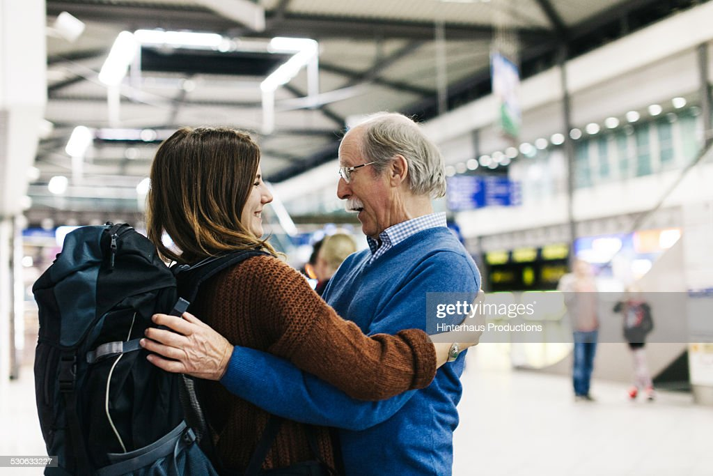 Grandfather Welcoming Young Traveller : Stock Photo