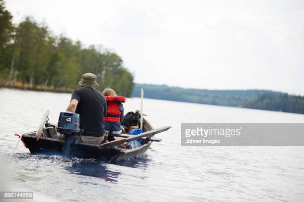 Grandfather with girl on boat