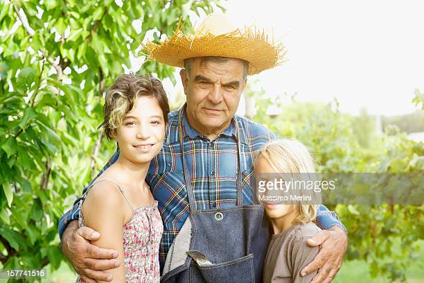 grandfather with grandchildren in the vineyard - nephew stock pictures, royalty-free photos & images