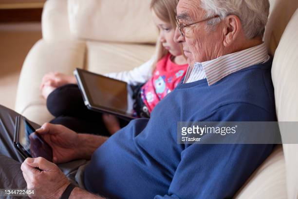 grandfather with granddaughter - st. albans stock pictures, royalty-free photos & images